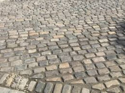 Gloucester Paving Contractors Laying Cobblestones in Gloucester